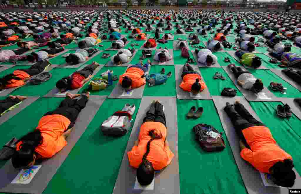 People perform yoga during a practice session ahead of the International Yoga Day, in Lucknow, India.
