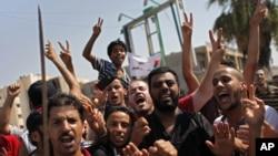 Libyans celebrate the liberation of their district of Qasr Bin Ghashir in Tripoli, Libya, August 27, 2011.