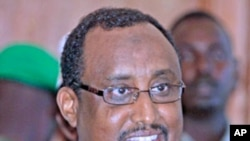 Somalia's Prime Minister Abdiweli Mohamed Ali addresses a news conference in the capital Mogadishu. Mohamed Ali was given the job full-time on Thursday by President Sheikh Sharif Ahmed and will form a government whose goal will be to quash a rebellion, Ju