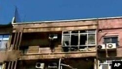 Nhà trong khu Mazzeh bị hư hại sau vụ chạm súng giữa nhóm nổi dậy và lực lượng an ninh hôm 19/3/12
