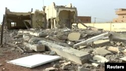 FILE - A still image taken from a video shot on June 29, 2018, shows damaged buildings inside the headquarters of the G5 Sahel military task force in Sevare, Mali.