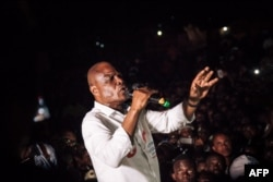 FILE - Democratic Republic of Congo joint opposition presidential candidate Martin Fayulu delivers a speech in front of his supporters in Beni, Dec. 5, 2018.