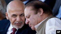 FILE - Afghan President Ashraf Ghani (l) talks with Pakistani Prime Minister Nawaz Sharif in Islamabad, Pakistan. After a recent brutal bombing in Kabul that killed 64 people and wounded 340, an outraged Ghani said he was no longer interested in Pakistan's help to bring the Taliban to the negotiating table and instead he wanted Pakistan to launch an all-out operation against the Haqqani network on its territory.
