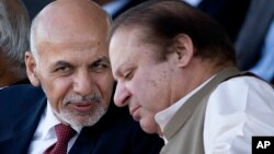FILE - Afghan President Ashraf Ghani (left) talks with Pakistani Prime Minister Nawaz Sharif in Islamabad, Pakistan.
