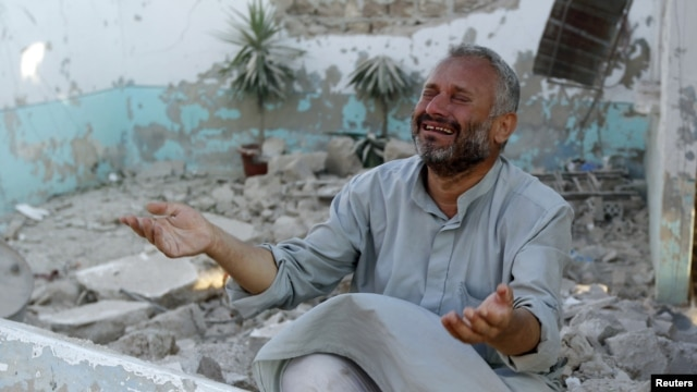 A man cries in front of houses destroyed during a recent Syrian Air Force air strike in Azaz, about 47 kilometers north of Aleppo, Syria, August 15, 2012.