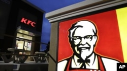 FILE - KFC says it plans to stop serving chicken raised with human antibiotics.