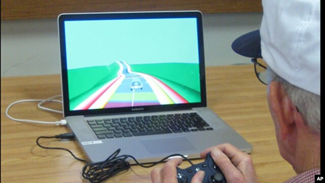 An elderly man plays a video game as part of a study at the University of California, San Francisco..