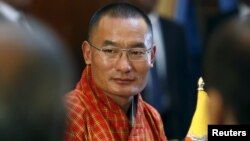 FILE - Bhutan's Prime Minister Tshering Tobgay looks on during a meeting with Sri Lanka's President Maithripala Sirisena (not pictured) in Colombo, April 10, 2015.