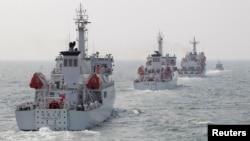 Tàu tuần tra của Cảnh sát biển Đài Loan trong một cuộc diễn tập ở tây bắc của cảng Cao Hùng, miền nam Đài Loan.