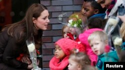 FILE - Britain's Catherine, Duchess of Cambridge talks to children as she leaves the Fostering Network offices in North London January 16, 2015. The Fostering Network is a charity which provides information about fostering, gives support and advice to its members, and campaigns to improve foster care.