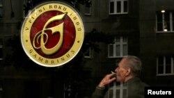 FILE - A customer smokes a cigarette in a pub in Prague, Czech Republic, May 25, 2016.