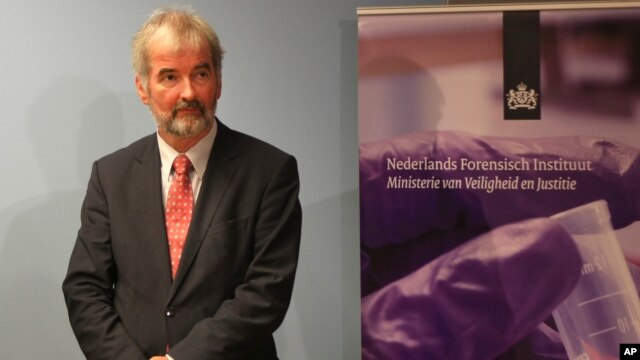 Wim Heijnen, head of medical forensic investigations at the Netherlands Forensic Institute, awaits the start of a press conference in The Hague, Netherlands, Aug. 27, 2014.