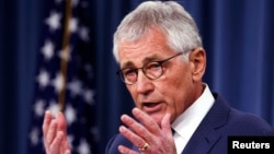 U.S. Defense Secretary Chuck Hagel talks to reporters at the Pentagon in Washington, Jan. 22, 2015.