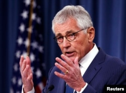 FILE - Then-U.S. Defense Secretary Chuck Hagel, shown talking to reporters in January 2015, said in a report that the Pentagon knows preventing sexual assault involves more than mere training or safety briefings.