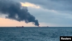 Smoke rises from two ships on fire in the Kerch Strait near Crimea, Jan. 21, 2019 in this still image taken from Reuters TV footage.