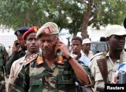 FILE - Somali military commander Abdulkadir Ali Dini speaks on a mobile phone at the scene of a suicide blast attack at Villa Baidoa in Mogadishu, Nov. 30, 2011.