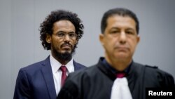 Ahmad Al Faqi Al Mahdi enters the courtroom of the International Criminal Court in the Netherlands