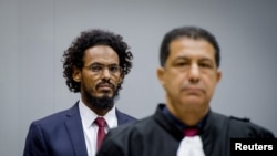 FILE - Ahmad Al Faqi Al Mahdi enters the courtroom of the International Criminal Court in the Netherlands