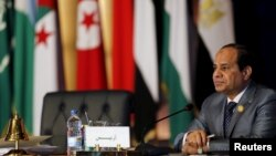 Egyptian President Abdel-Fattah el-Sissi attends during the closing session of the Arab Summit in Sharm el-Sheikh, in the South Sinai governorate, south of Cairo, March 29, 2015.