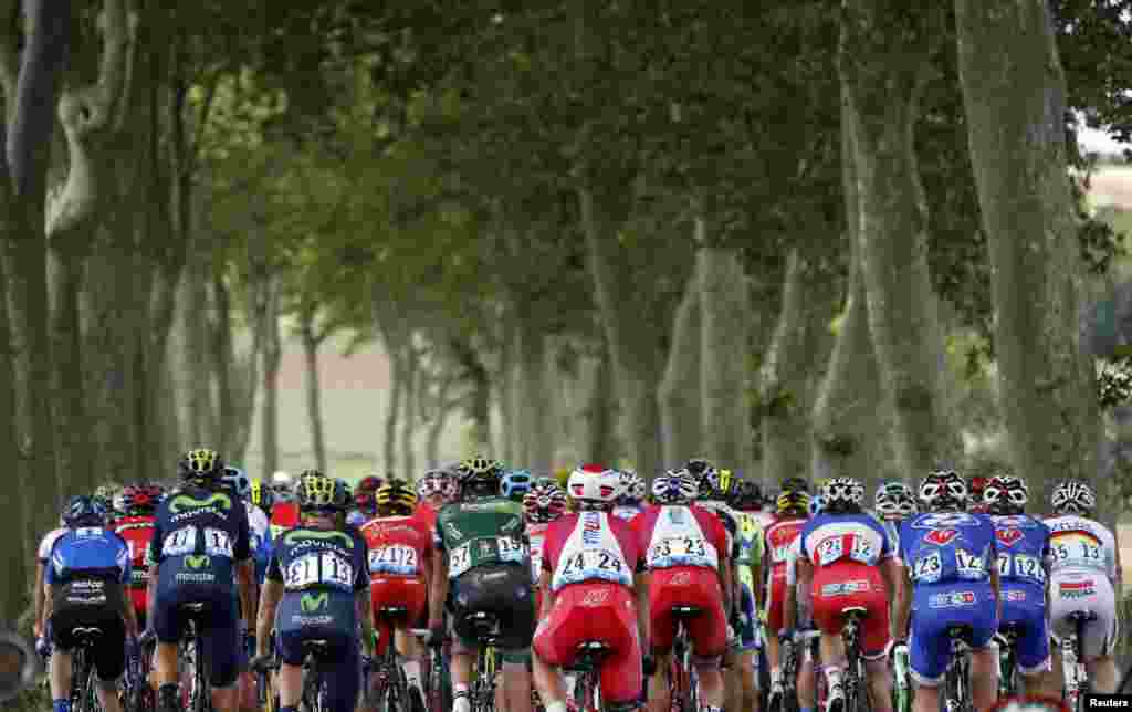 The pack of riders cycles on its way during the 237.5km 16th stage of the Tour de France cycling race between Carcassonne and Bagneres-de-Luchon, France.