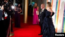 Kennedy Center Honoree Billy Joel and girlfriend Alexis Roderick arrive for the Kennedy Center Honors in Washington, Dec. 8, 2013.