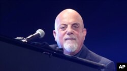 Singer-songwriter Billy Joel will perform the national anthem at Game 3 of the baseball World Series.