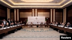 Syrian Opposition Coalition members and Syrian National Coalition members attend a meeting in Istanbul, March 18, 2013.