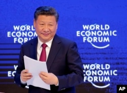FILE - China's President Xi Jinping looks on at the World Economic Forum in Davos, Switzerland, Jan. 17, 2017.