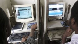 Nigerians use the internet at a cybercafe in Lagos, Nigeria