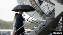 U.S. President Donald Trump and first lady Melania Trump depart from Glasgow Prestwick Airport in Prestwick, Britain, July 15, 2018.