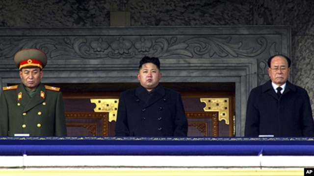 In this photo taken Thursday, Dec. 29, 2011, new North Korean leader Kim Jong Un, center, presides over a national memorial service for his late father Kim Jong Il at Kim Il Sung Square in Pyongyang, North Korea. Flanking him are Kim Yong Nam, president o