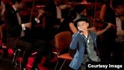 'LUKE' NAPHAT SATHEINTHIRAKUL PERFORMS ON STAGE IN A SINGING CONTEST IN THAILAND (Cr: Luke Naphat)
