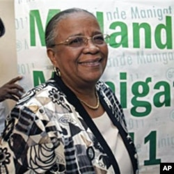 Haiti's presidential candidate and former first lady Mirlande Manigat smiles after a press conference in Port-au-Prince, Mar 14 2011