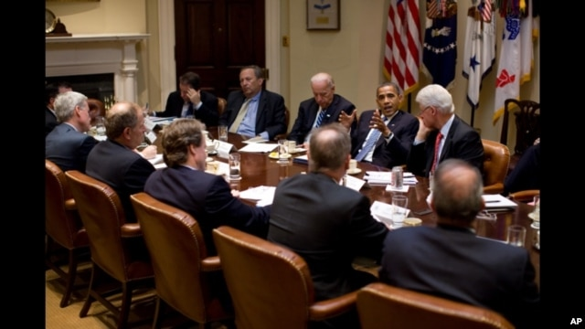 President Obama and Vice President Joe Biden meet with President Bill Clinton and business leaders in the White House, 14 July 2010