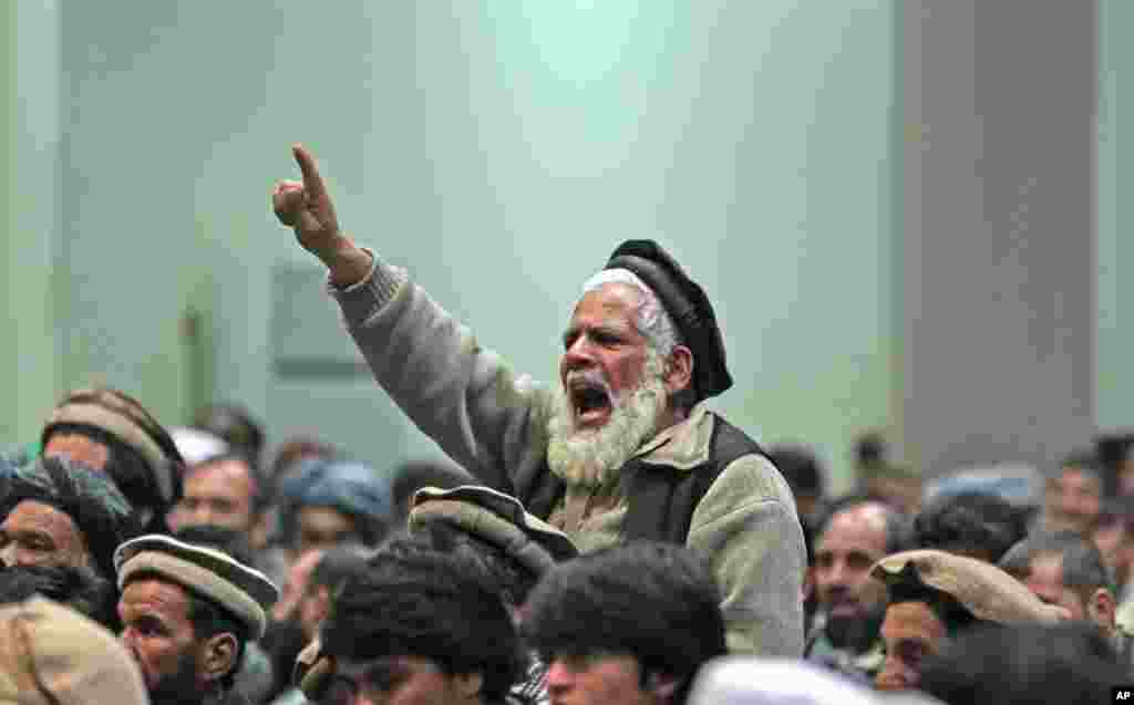 A supporter of Afghan presidential candidate Abdul Rasoul Sayyaf chants slogans during a campaign rally in Kabul, March 6, 2014.