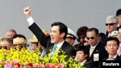 FILE - Taiwan's President Ma Ying-jeou raises his fist after giving a speech during National Day celebrations in front of the presidential office in Taipei.