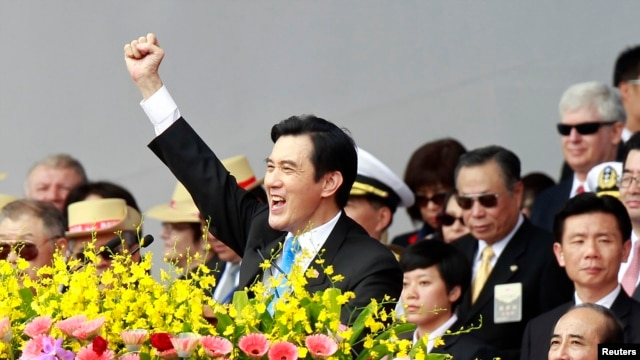 FILE - Taiwan's President Ma Ying-jeou raises his fist after giving a speech during National Day celebrations in front of the presidential office in Taipei, Oct. 10, 2013.