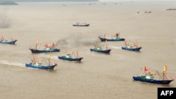 FILE - Chinese fishing boats set off to fish near the disputed Diaoyu Islands, also known as the Senkaku Islands in Japan, from Shipu fishing port in Xiangshan county, east China's Zhejiang province.