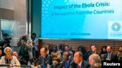 From left, IMF Managing Director Christine Lagarde, World Bank Group President Jim Yong Kim, Guinea's President Alpha Conde and United Nations Secretary-General Ban Ki-moon address the Ebola crisis during the IMF-World Bank annual meetings in Washington,