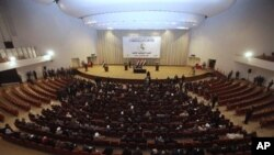 Iraqi lawmakers attend a session of parliament in Baghdad (file photo)