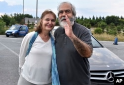 Mehmet Altan, a Turkish newspaper columnist and academic, and his wife Umit Altan, speak to the media after being released from the prison in Silivri, near Istanbul, June 27, 2018.