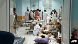 In this undated photograph released by Doctors Without Borders (MSF) on October 3, 2015, medical personnel treat injured civilians at the MSF hospital in Kunduz province, Afghanistan. MSF announced Saturday that it hopes to reopen the bombed hospital next year.