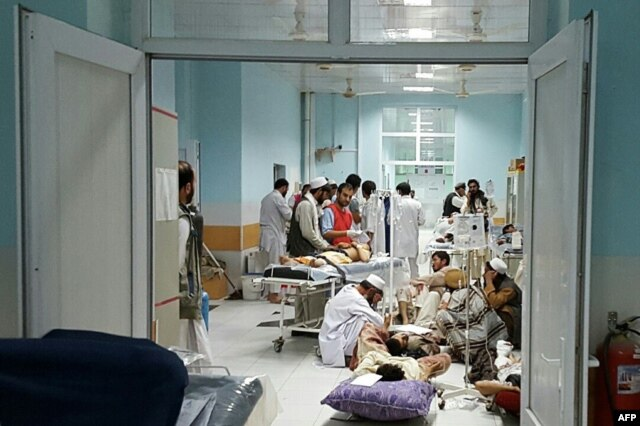 In this undated photograph released by Doctors Without Borders (MSF) on Oct. 3, 2015, Afghan MSF medical personnel treat civilians injured following an offensive against Taliban militants by Afghan and coalition forces at the MSF hospital in Kunduz.