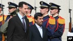 Syrian President Bashar al-Assad and Iranian President Mahmoud Ahmadinejad (file)