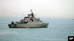 FILE - In this picture taken April 7, 2015, and released by the semiofficial Fars News Agency, the Iranian warship Alborz, foreground, prepares before leaving Iran's waters, at the Strait of Hormuz. Located on the eastern edge of the Persian Gulf, the Strait of Hormuz is one of the world's most important export routes.