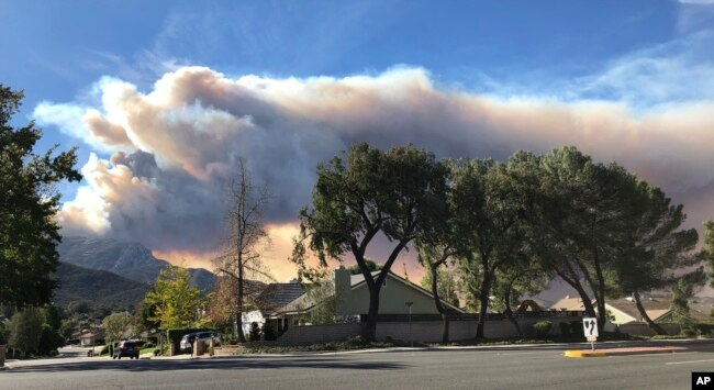 A large wildfire plume from a recent flareup near Lake Sherwood, California, is visible from Thousand Oaks, California, Nov. 13, 2018.