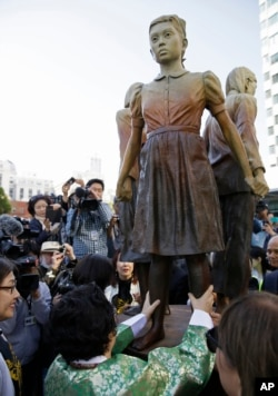 "Former World War II ""comfort woman"" Yongsoo Lee, 89, of South Korea, walks around the ""Comfort Women"" monument after it was unveiled, Sept. 22, 2017, in San Francisco. The monument was dedicated to the young women victims of Japanese military sexual slavery."