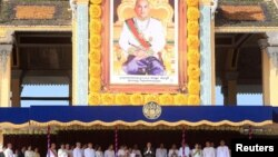 Cambodia's King Norodom Sihamoni (C) greets people from the Royal Palace during a ceremony to mark the 10th anniversary of his coronation, in Phnom Penh October 29, 2014. Cambodians marked the anniversary on Tuesday and Wednesday.