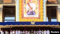 Cambodia's King Norodom Sihamoni (C) greets people from the Royal Palace during a ceremony to mark the 10th anniversary of his coronation, in Phnom Penh October 29, 2014.