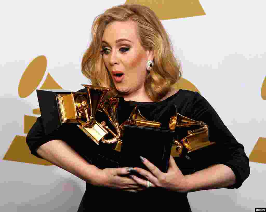 February 12: Singer Adele holds her six Grammy Awards at the 54th annual Grammy Awards in Los Angeles, California.